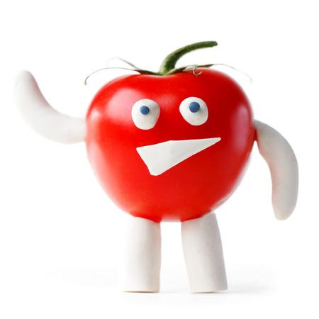 Funny tomato mascot waving you isolated on white background photo