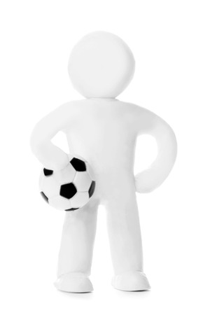 Plasticine man with soccer ball isolated on white background photo