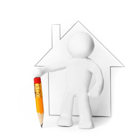 Plasticine man with pencil presenting house isolated on white background photo