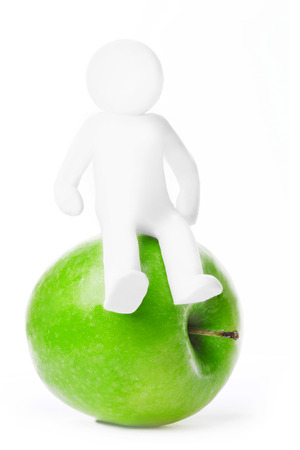 Plasticine man sitting on apple isolated on white background photo