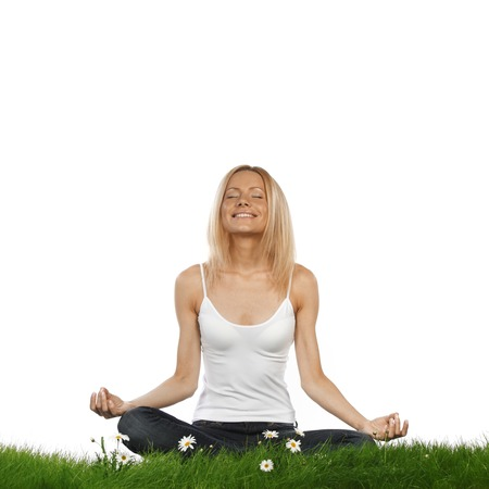 Yoga woman on green grass in lotus pose, isolated on white background photo