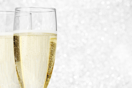 festive occasions: Two champagne glasses on silver bokeh background Stock Photo