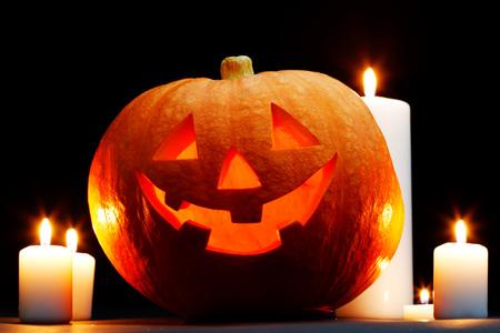 jack o lantern: Halloween Jack O Lantern pumpkin and candles on black background