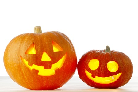 Two cute Halloween pumpkins isolated on white background Foto de archivo