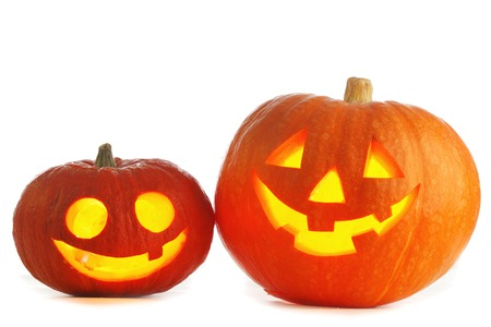 Two funny Halloween Jack O Lantern pumpkins on black background Stock Photo