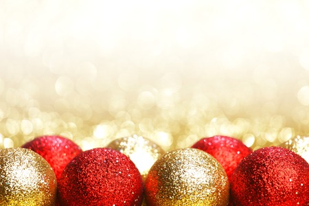 red and gold: Pile of colorful Christmas balls with blurred background