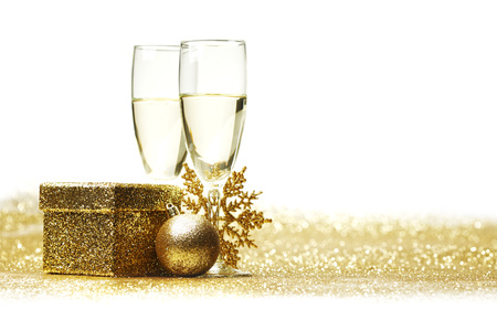 champagne glasses: Champagne glasses and christmas decor on glitters with white copy space Stock Photo