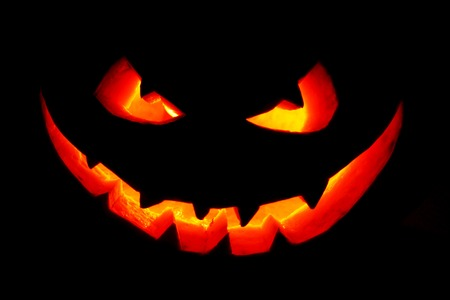 jack o  lantern: Funny Halloween Jack O Lantern pumpkin smile isolated on black background Stock Photo