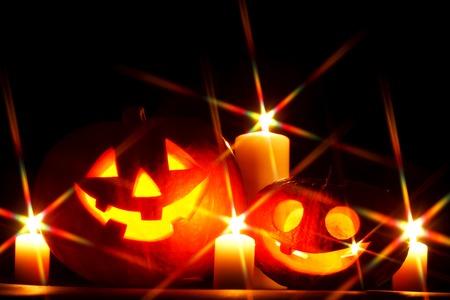 jack o  lantern: Halloween Jack O Lantern pumpkins and candles on black background Stock Photo