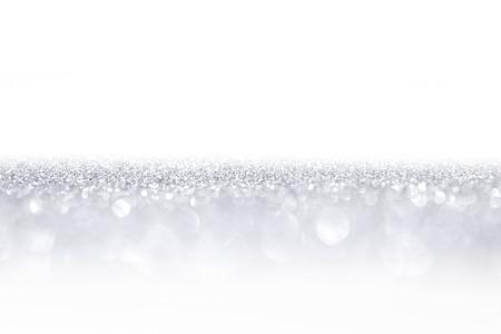 Silver glitter background with beautiful bright bokeh lights and white copy space Stockfoto