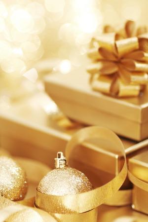 christmas gift box: Golden christmas gift box and christmas balls on bokeh light background Stock Photo
