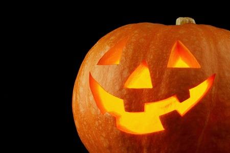 jack o lantern: Funny Halloween Jack O Lantern pumpkin on black background