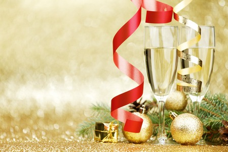 christmas decor: Champagne and christmas decor on glitter background