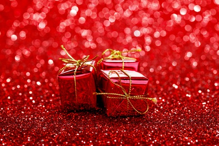 Small Decorative Gift Boxes On Shiny Glitter Background Stock Photo Magnificent Small Decorative Gift Boxes
