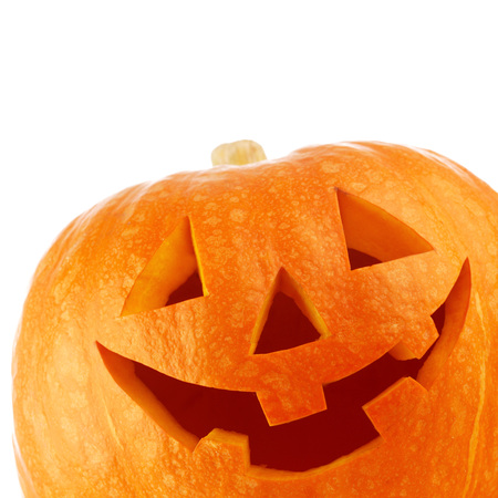 carved pumpkin: Funny Halloween Jack O Lantern carved pumpkin isolated on white background Stock Photo