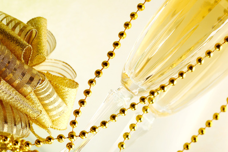 new year eve beads: New year champagne glasses and golden decoration Stock Photo