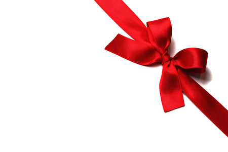 gift background: Shiny red satin ribbon with bow on white background Stock Photo