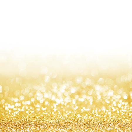 Golden festive glitter background with defocused lights 스톡 콘텐츠