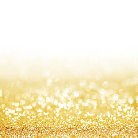 Golden festive glitter background with defocused lights Standard-Bild