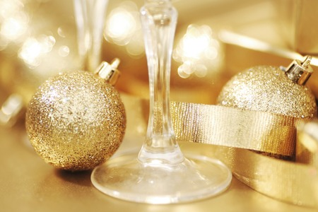champagne glasses: New year champagne glasses and golden decoration Stock Photo