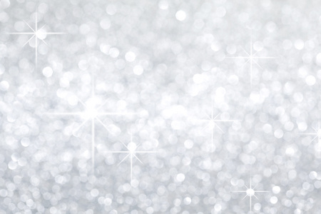 silver background: Silver festive glitter background with defocused lights Stock Photo