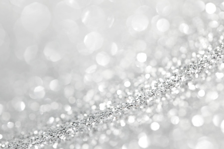 Silver glitter background with beautiful bright bokeh lights