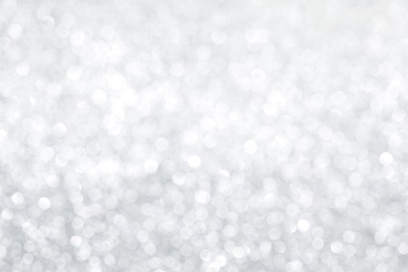 to white: Silver bokeh abstract light holiday background
