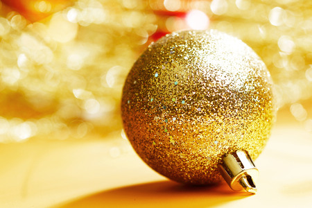 golden ball: Golden Christmas ball on abstract glitter background