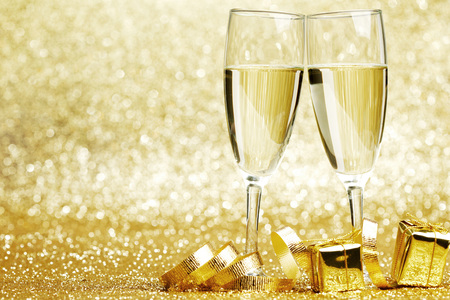champagne glasses: Champagne glasses and gifts on glitters background