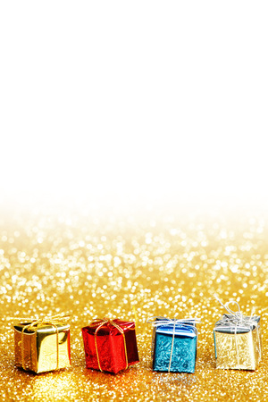 red and gold: Small decorative colorful presents on glitter background