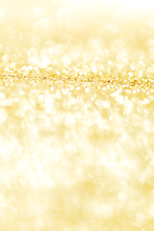 golden light: Abstract shining glitters gold holiday bokeh background Stock Photo