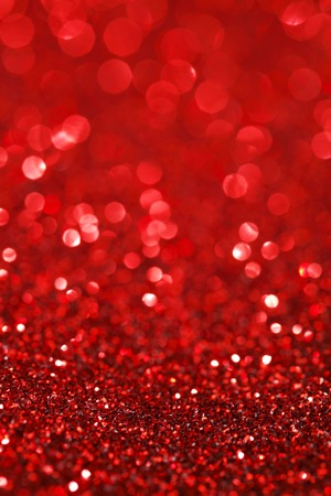 glimmer: Red bokeh holiday textured glitter background