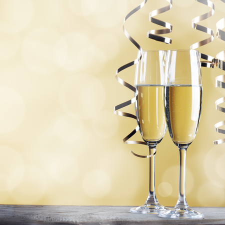 champagne party: Two glasses of champagne and ribbons on light bokeh background Stock Photo