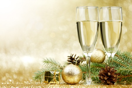 and  celebrate: Champagne and new year decorations on golden background