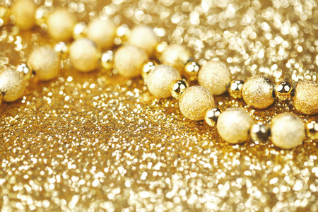 christmas beads: Golden decorative christmas beads on glitter background close-up