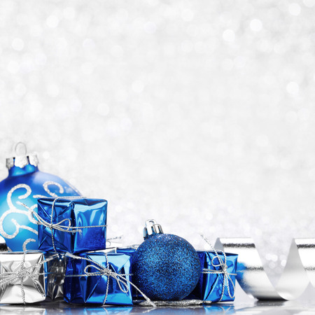 shiny christmas baubles: Christmas gifts and decoration on shiny glitter background Stock Photo
