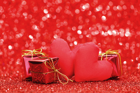 hearts background: Decorative handmade hearts and gifts on shiny glitter background