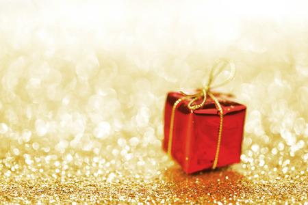 shiny: Decorative red box with holiday gift on shiny glitter background