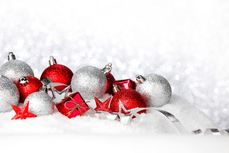 ball: Red and silver christmas balls and decoration on snow Stock Photo