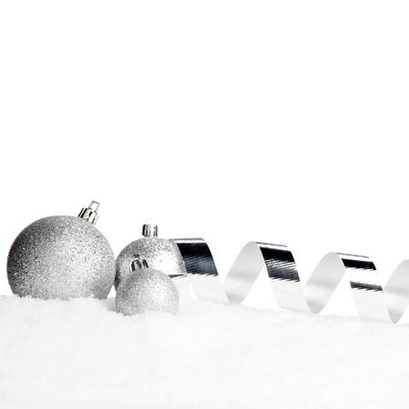 christmas decor: Beautiful various silver christmas decor on snow close-up Stock Photo