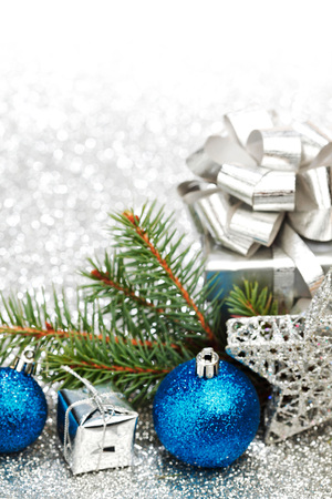 christmas tree branch: Christmas fir tree branch and decoration on silver glitter background Stock Photo