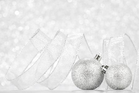 light circular: Christmas decorative balls on light silver bokeh background