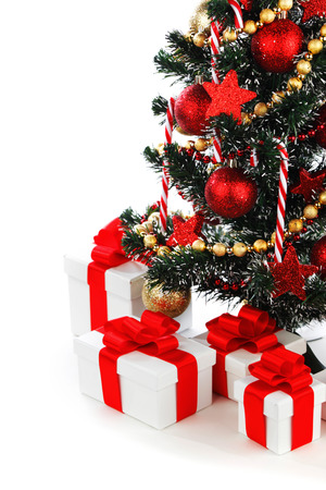 decorated christmas tree: Decorated Christmas tree and presents isolated on white background