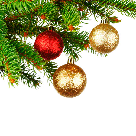 christmas tree branch: Christmas tree branch with decoration ball isolated on white Stock Photo