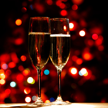 champagne glasses: Two champagne glasses on color bokeh background