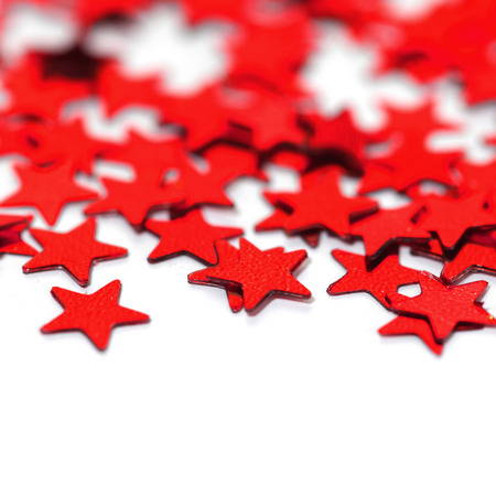 christmas red: Red decorative stars isolated on white background Stock Photo