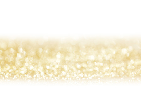 Golden decorative glitters on white background