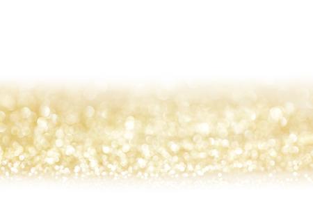 Golden decorative glitters on white background