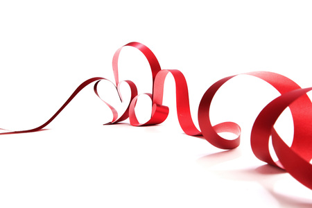 ribbon tape: Hearts from red ribbon isolated on white background Stock Photo