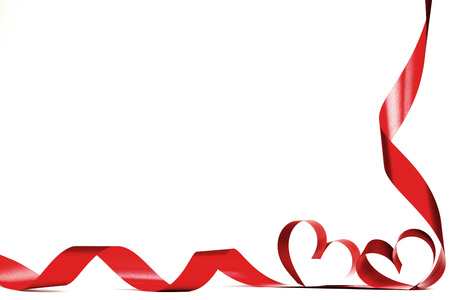 Valentines day frmae made of red ribbon hearts, isolated on white Foto de archivo